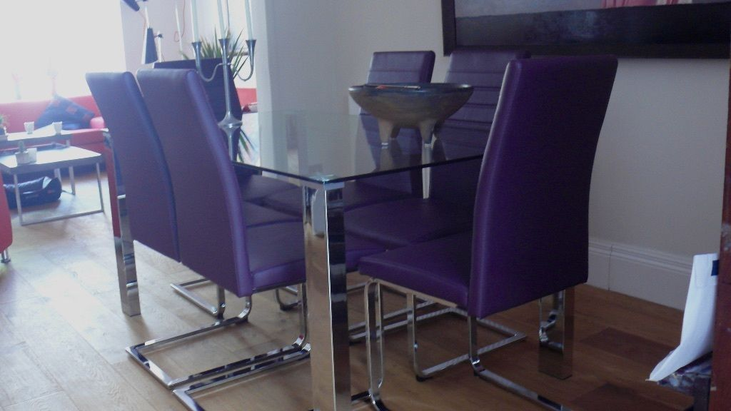 Glass/ chrome table dining set as new! with six plum coloured chairs. Bargain!