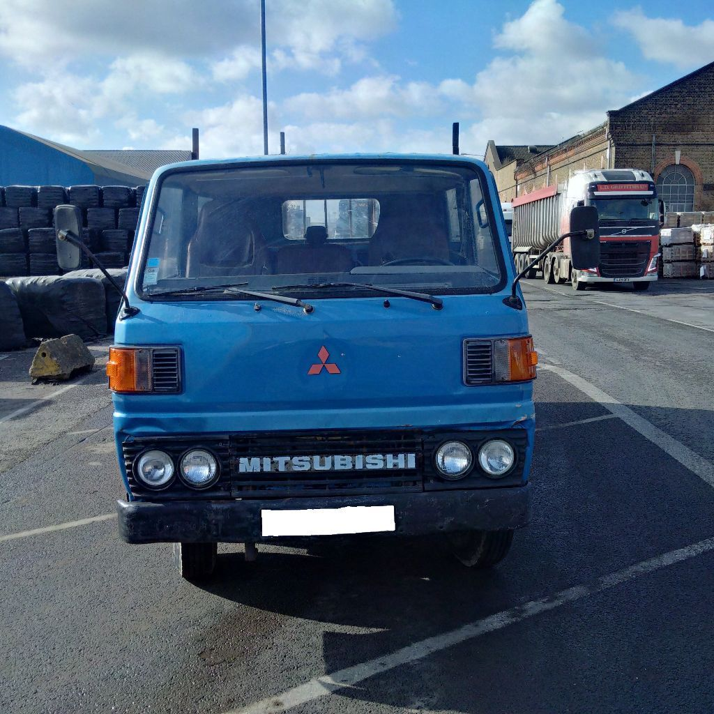 Left hand drive Mitsubishi Canter FE110 5.5 Ton 6 tyres truck. Steel body.