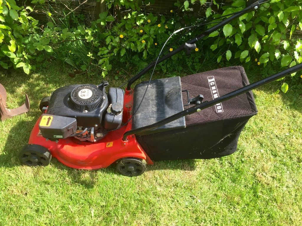 Champion Petrol Lawn Mower selling as Spares Or Repairs
