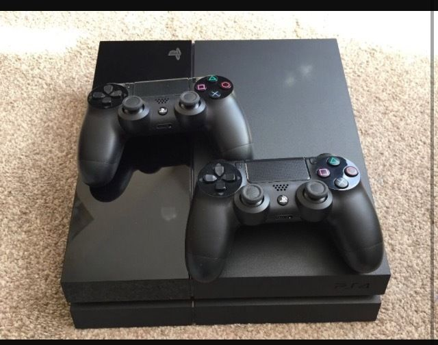 PlayStation 4 with 2 controllers and games