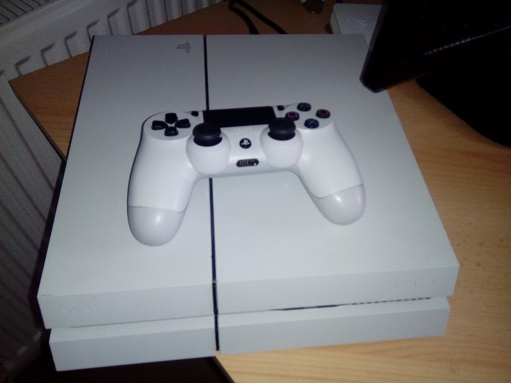 Ps4 consoles boxed as new with 4 games