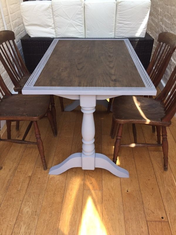 Beautiful dark wood table with 4 chairs