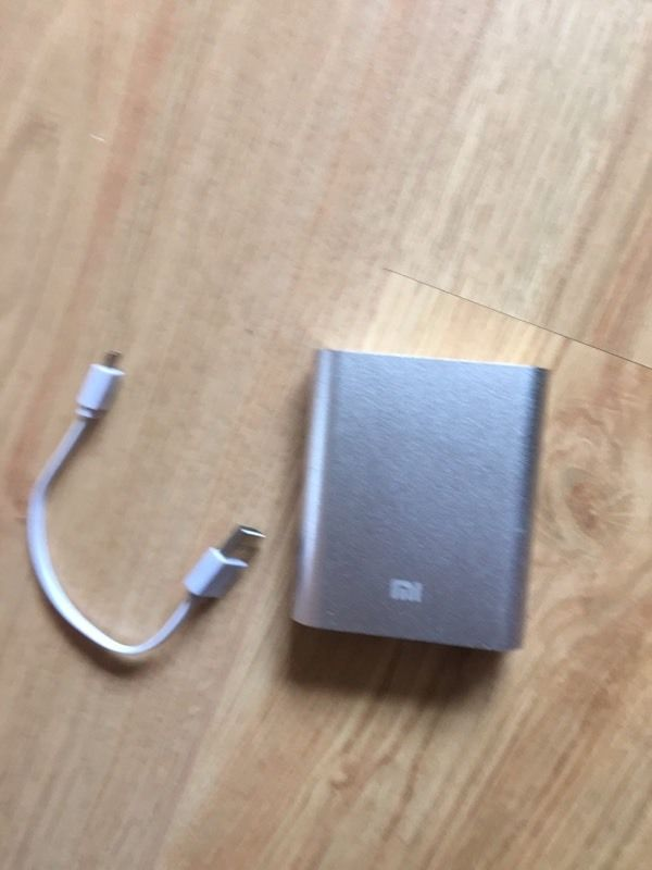 Portable phone charger with adaptable cables