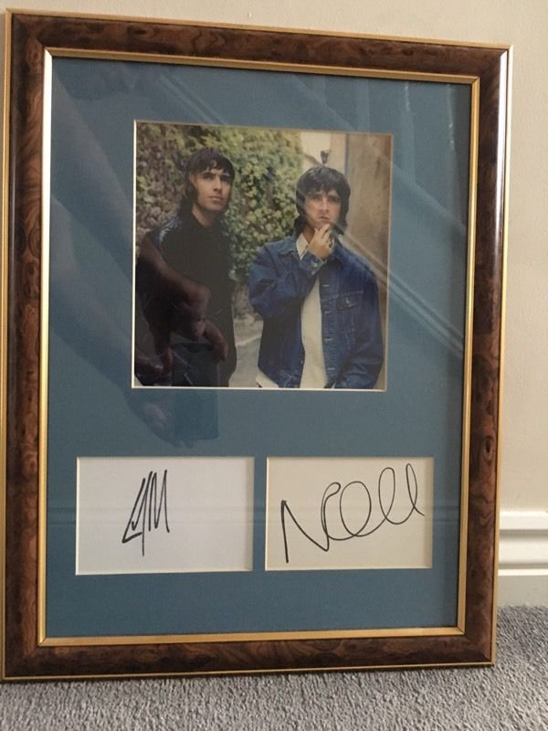 Signed and framed Liam and Noel Gallagher autographs
