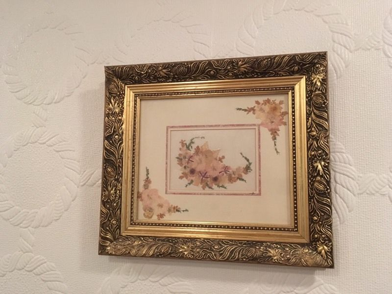 Gold effect frame and flower print