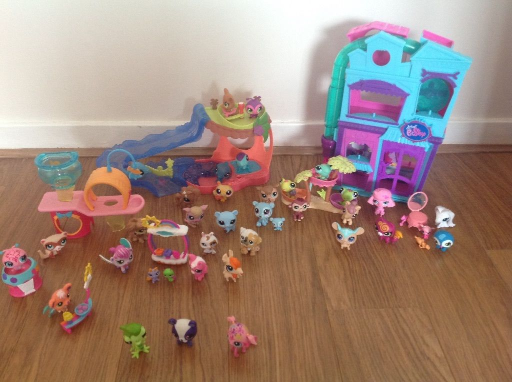 A bundle of Littlest Pet Shop toys including 6 sets and 38 characters