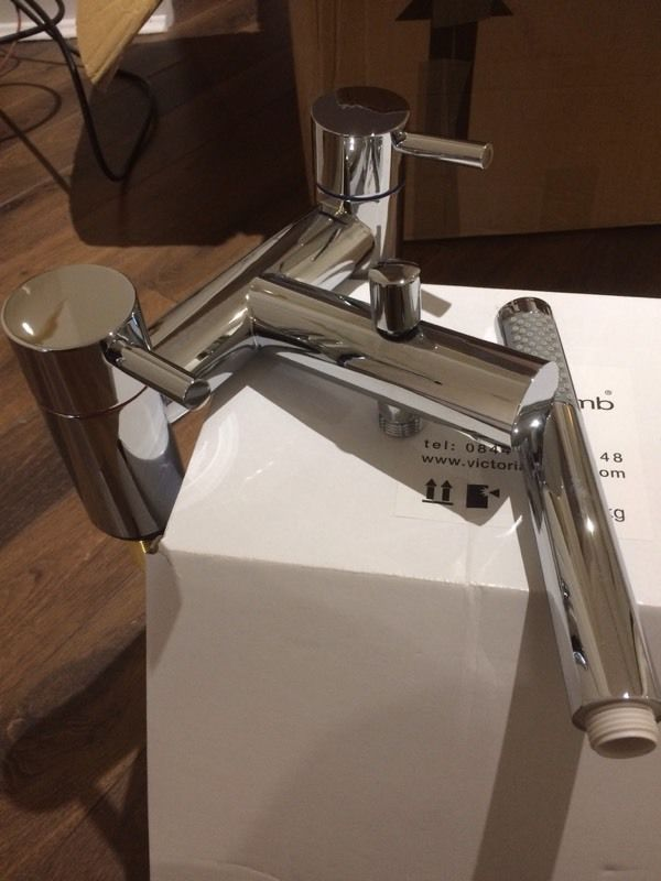 Modern basin taps and bath mixer tap with shower attachment