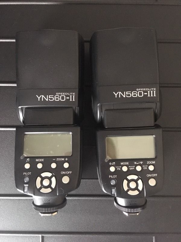 Two Yongnuo flashguns