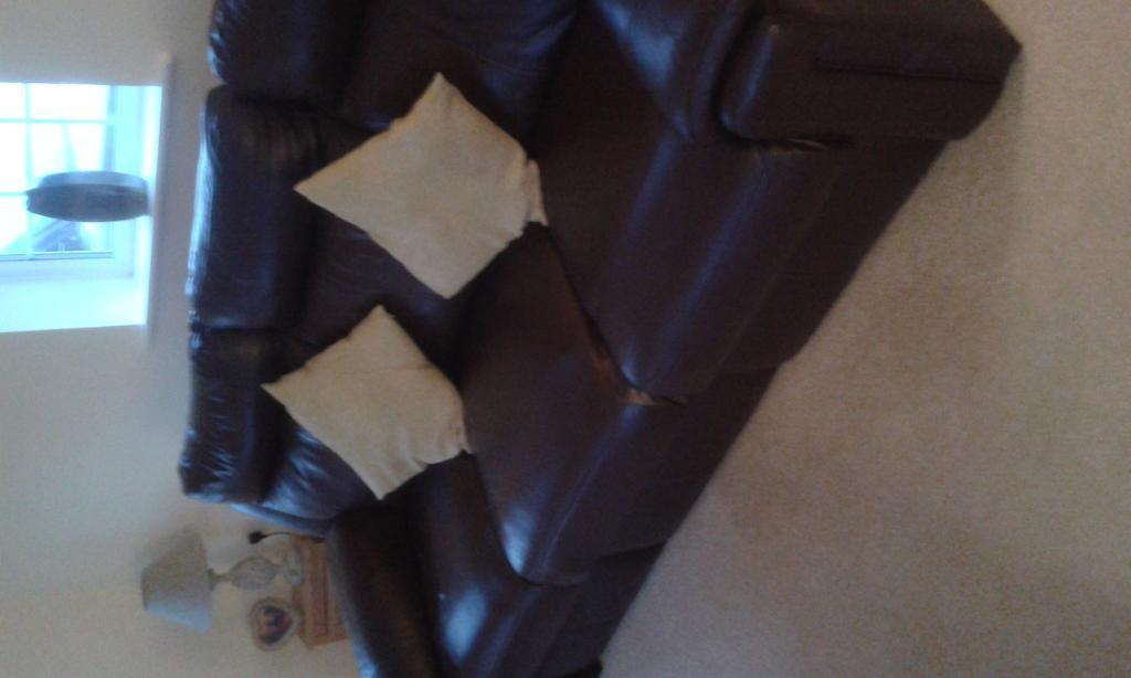 Brown leather reclining suite