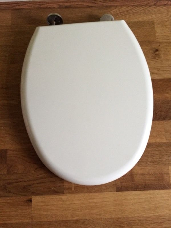 White,brand new toilet seat