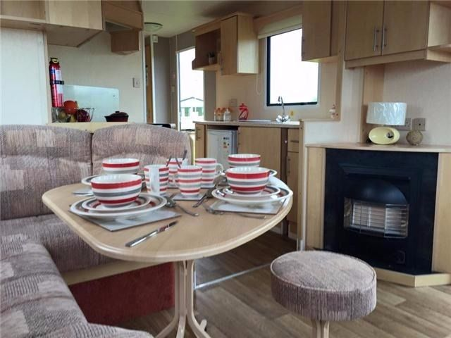 **GREAT STARTER CARAVAN WITH 2016 SITE FEES ALREADY PAID AT SANDY BAY WITH DIRECT BEACH ACCESS**