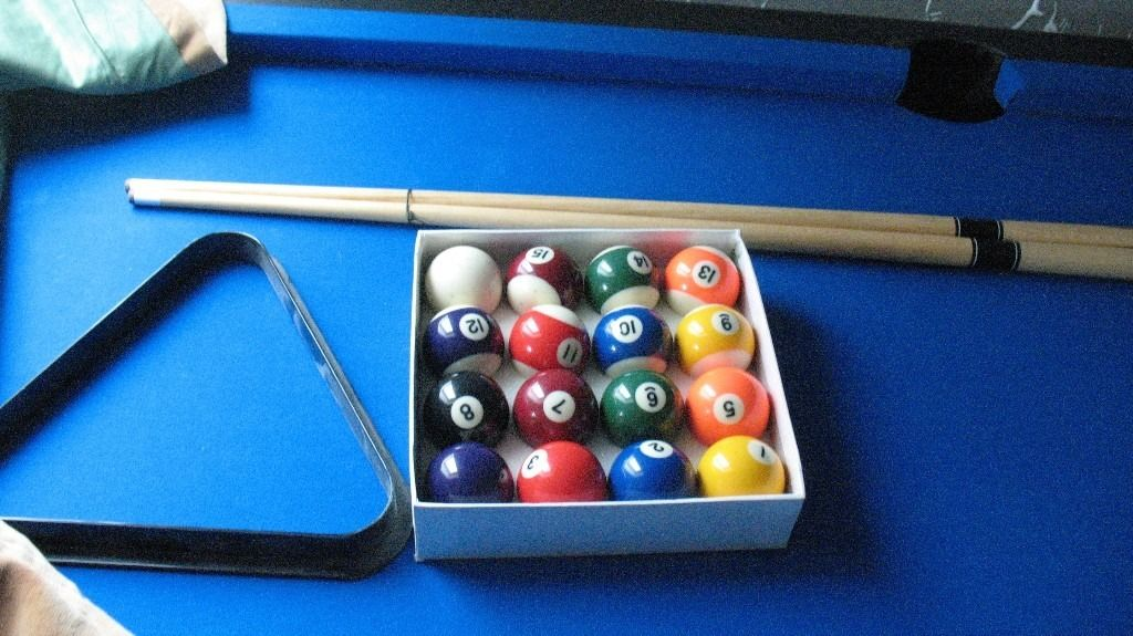 Ripley 6ft by 3ft pool table with spot/strip balls, triangle and two cues.