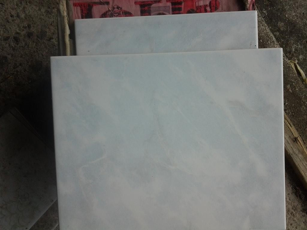 New wall tiles for sale. Pale blue & white pattern.