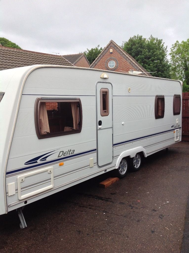 Lunar delta 640ew 2005 4 berth fixed bed twin axle Chris registration document