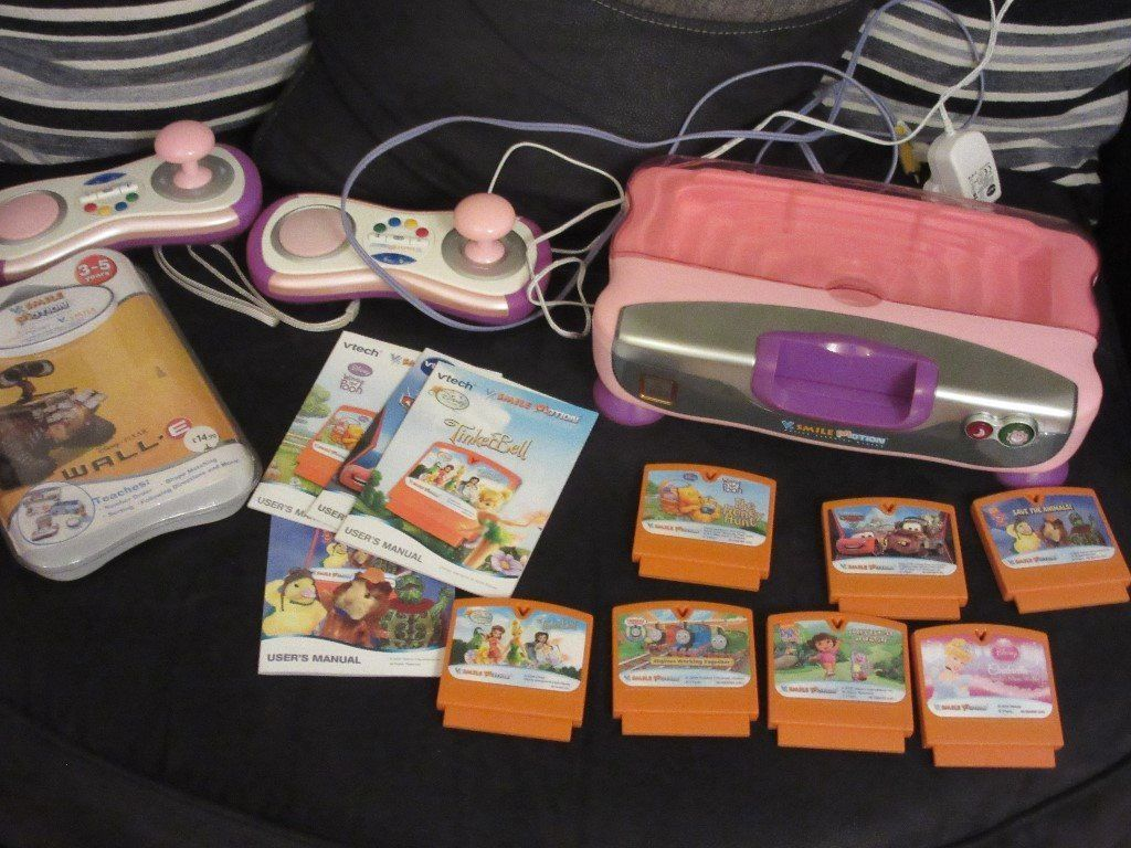 VTech Smile Motion Console with 2 controllers and 8 games