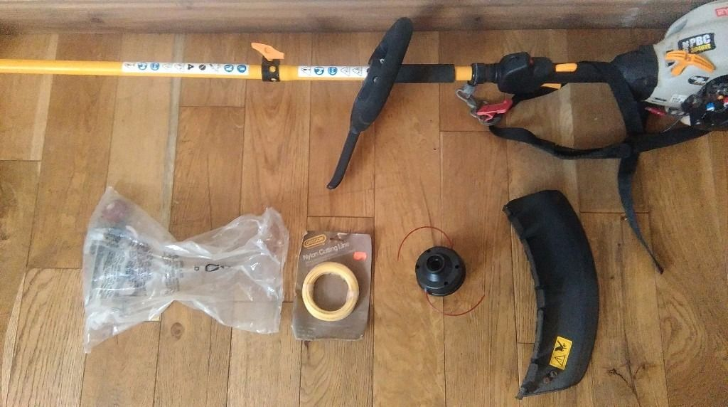 RYOBI 30CC Strimmer with blade and cord.