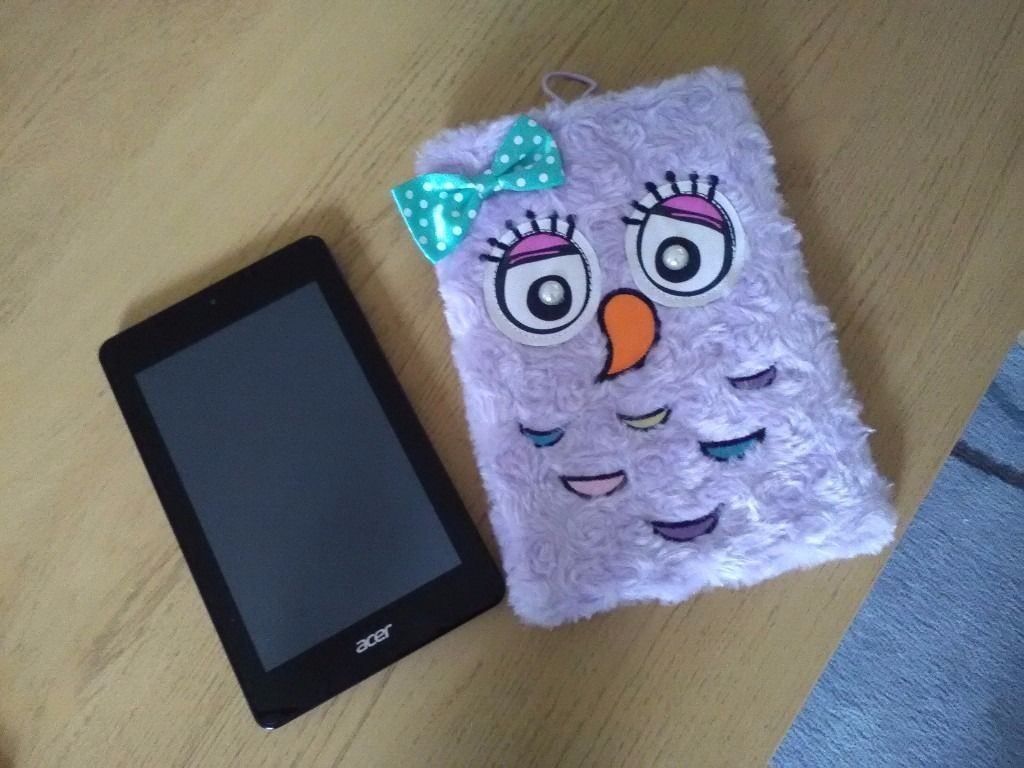 Purple acer iconia one tablet. Vgc used only 3 months. With the furry case