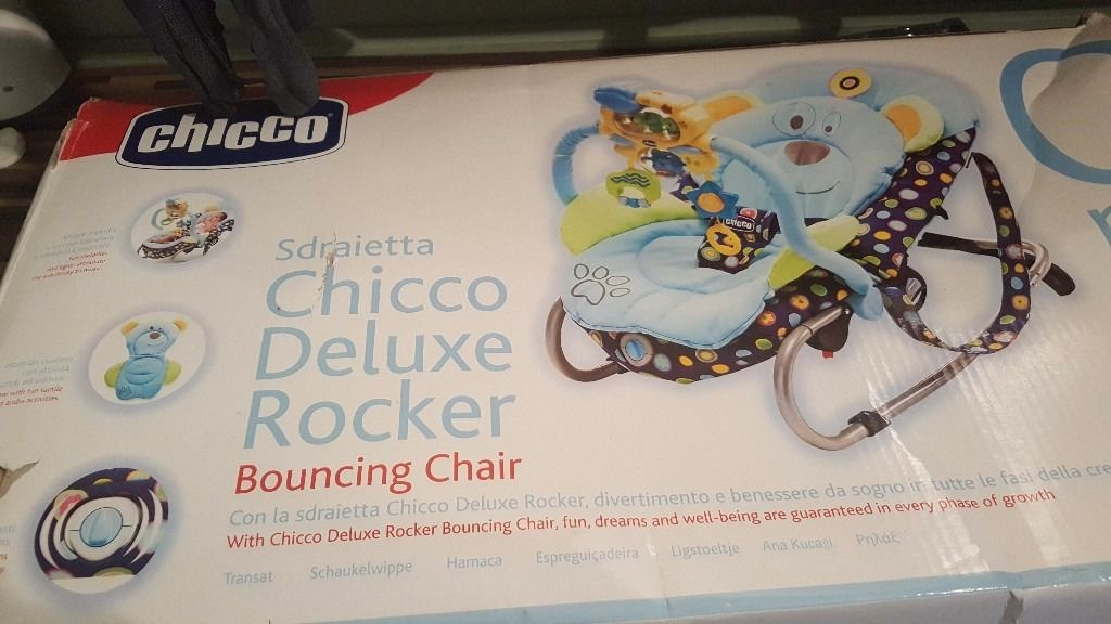 Chicco delux rocker with vibration multi position seat and music and interactive toys and bear band.