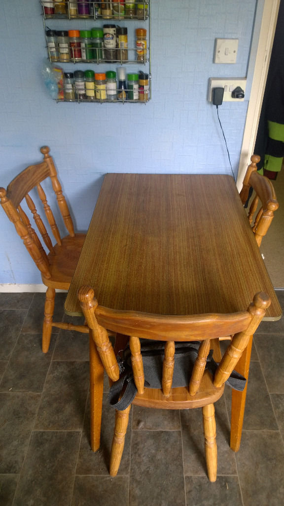 Kitchen dining table and three chairs