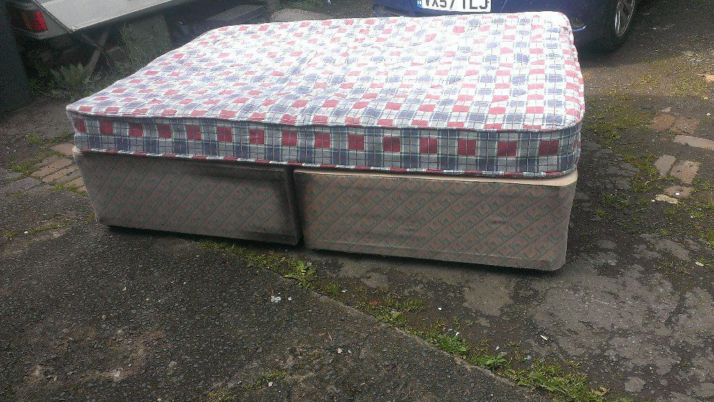 Double divan bed with mattress.