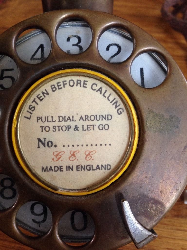 Old brass candle stick phone
