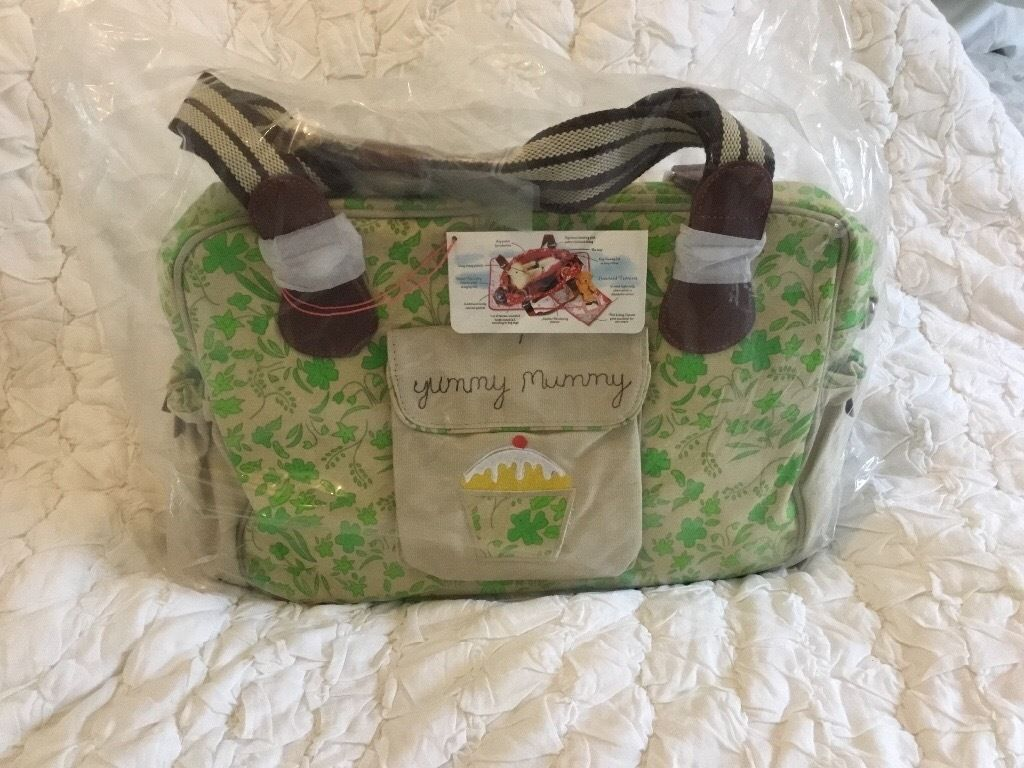 Brand new, never used. Pink Lining Green Floral Yummy Mummy Changing Bag