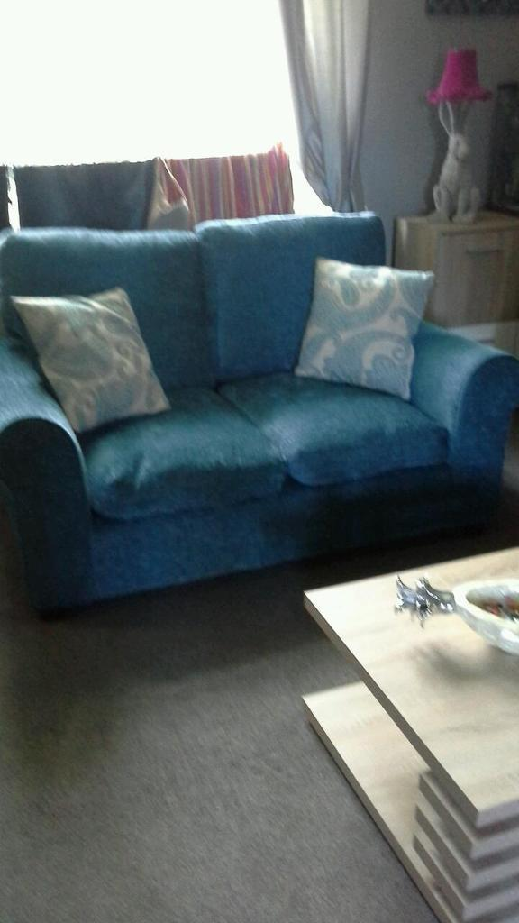 2x2 teal couches