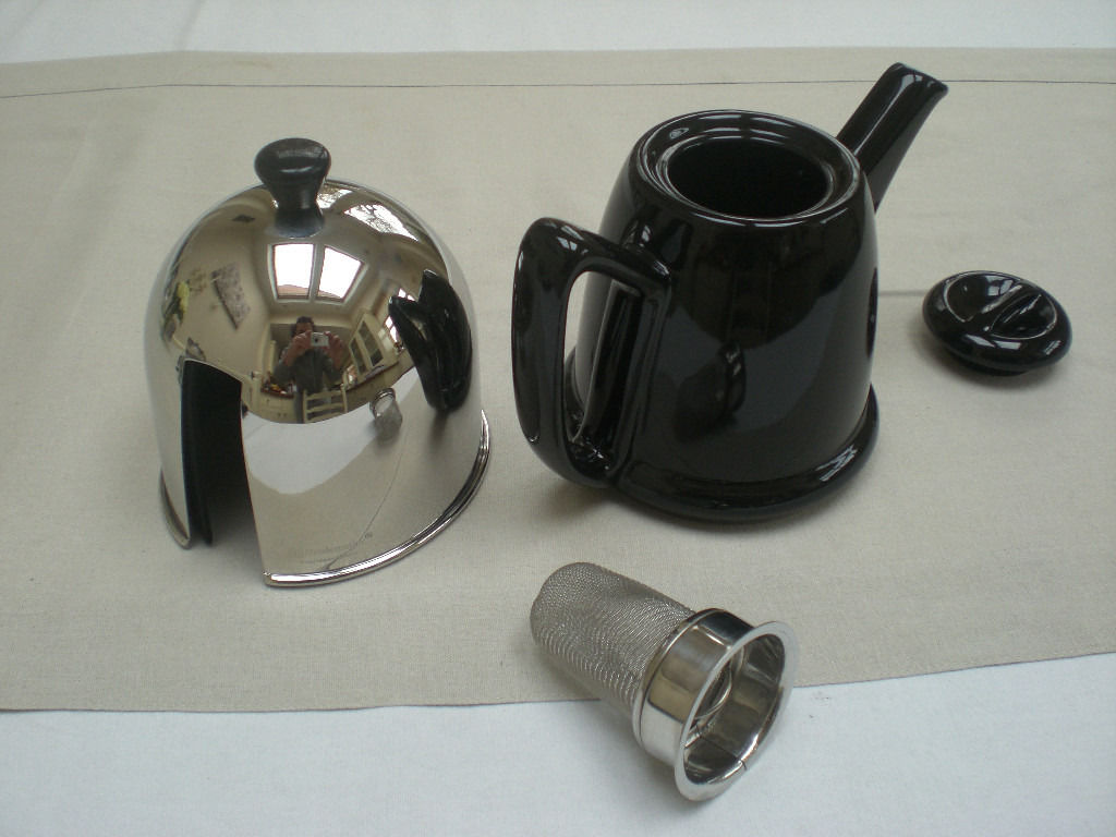 Unused and boxed, lovely modern teapot with steel cosy