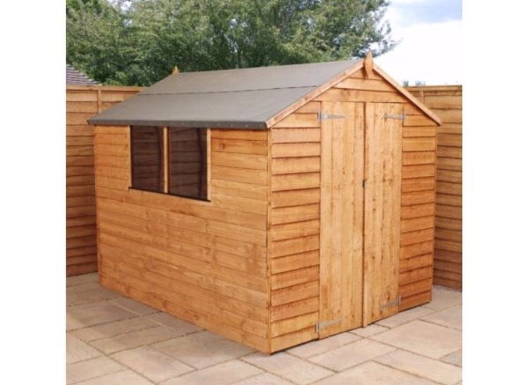 Sheds in many styles and sizes ,summerhouses, delivered, assemble with a base and treated