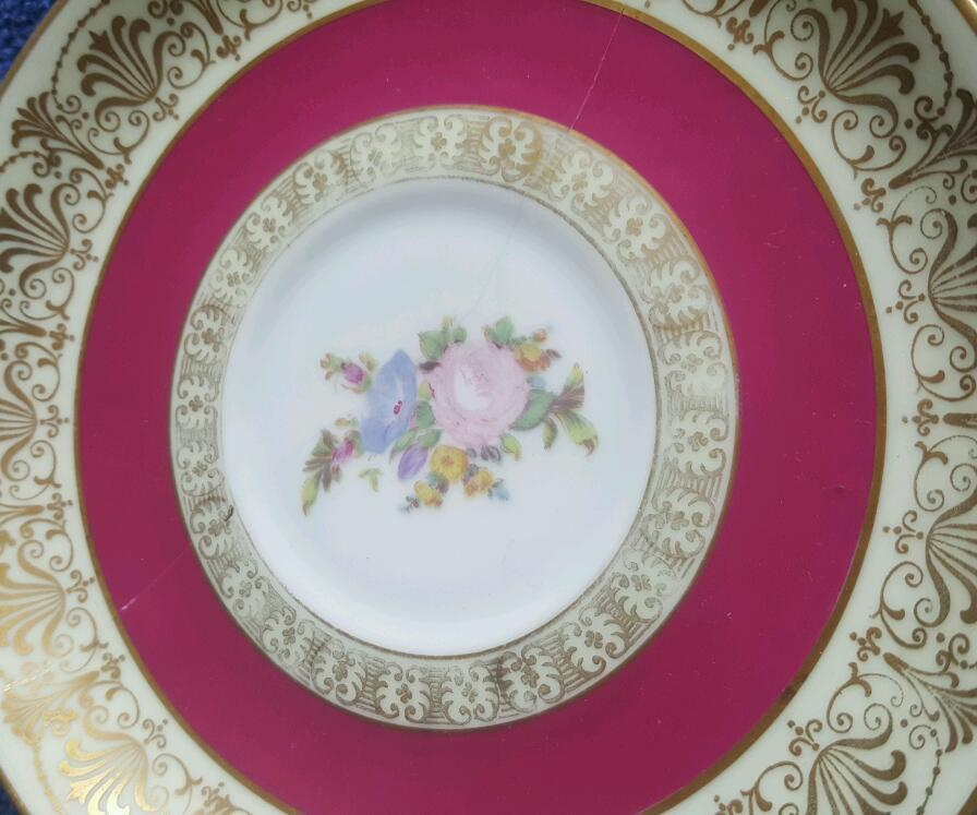 Assorted fine china plates different sizes