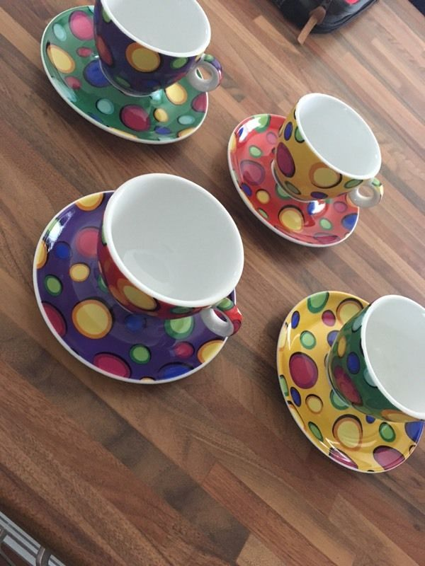 New boxed set of 4 cups and saucers
