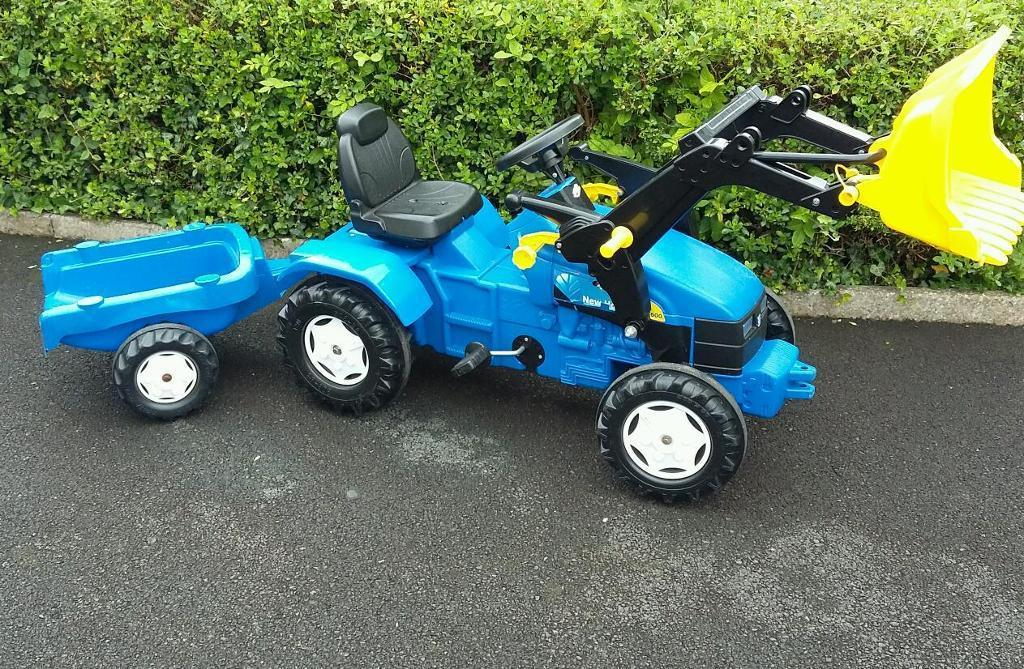 Large Blue New Holland TM175 toy tractor with trailer