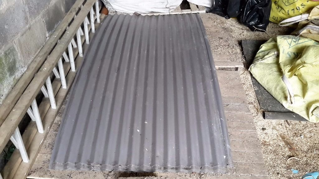 Curved corrugated zinc sheets
