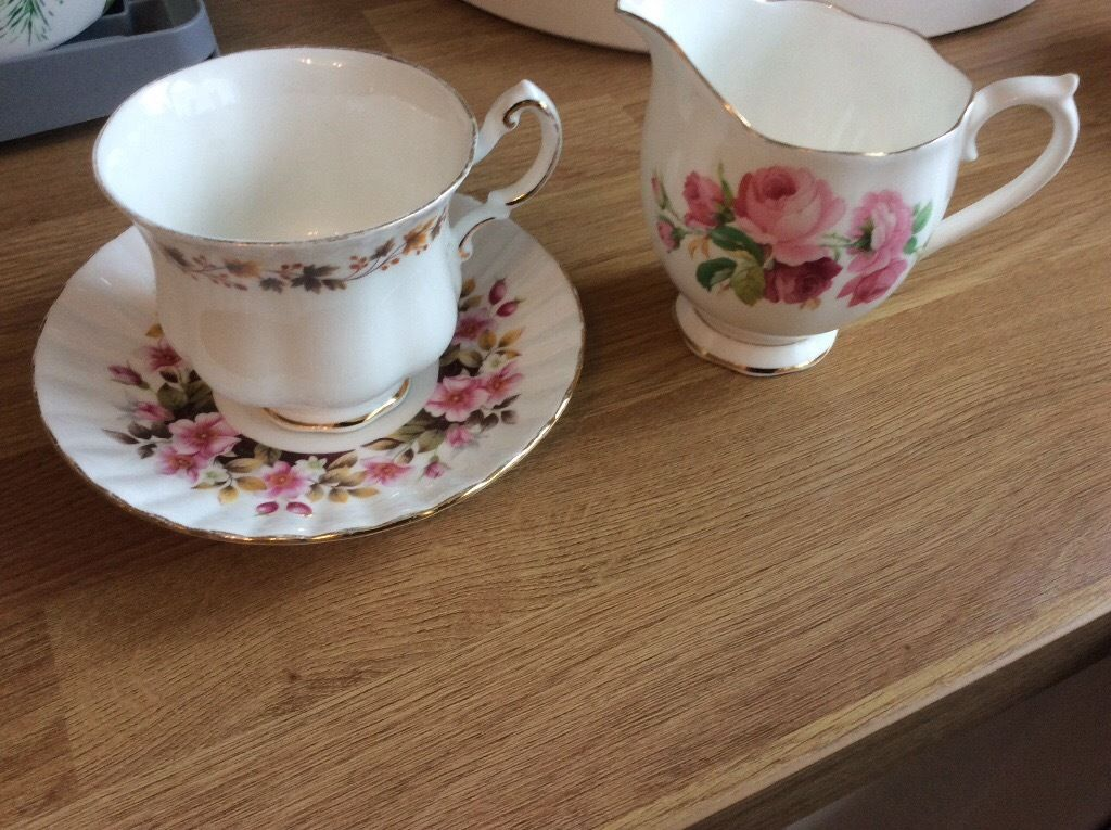 Bone china cup saucer and milk / cream jug.