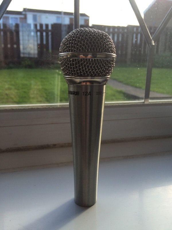 Sure microphone vintage nice shiny chrome not cheap tack.