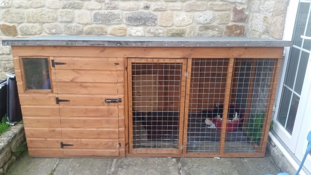 Large wooden kennel with run