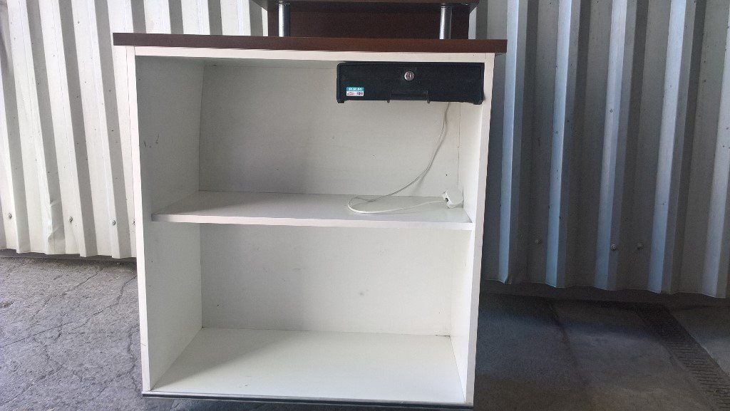 Reception desk with storage and cash drawer behind. Great Condition