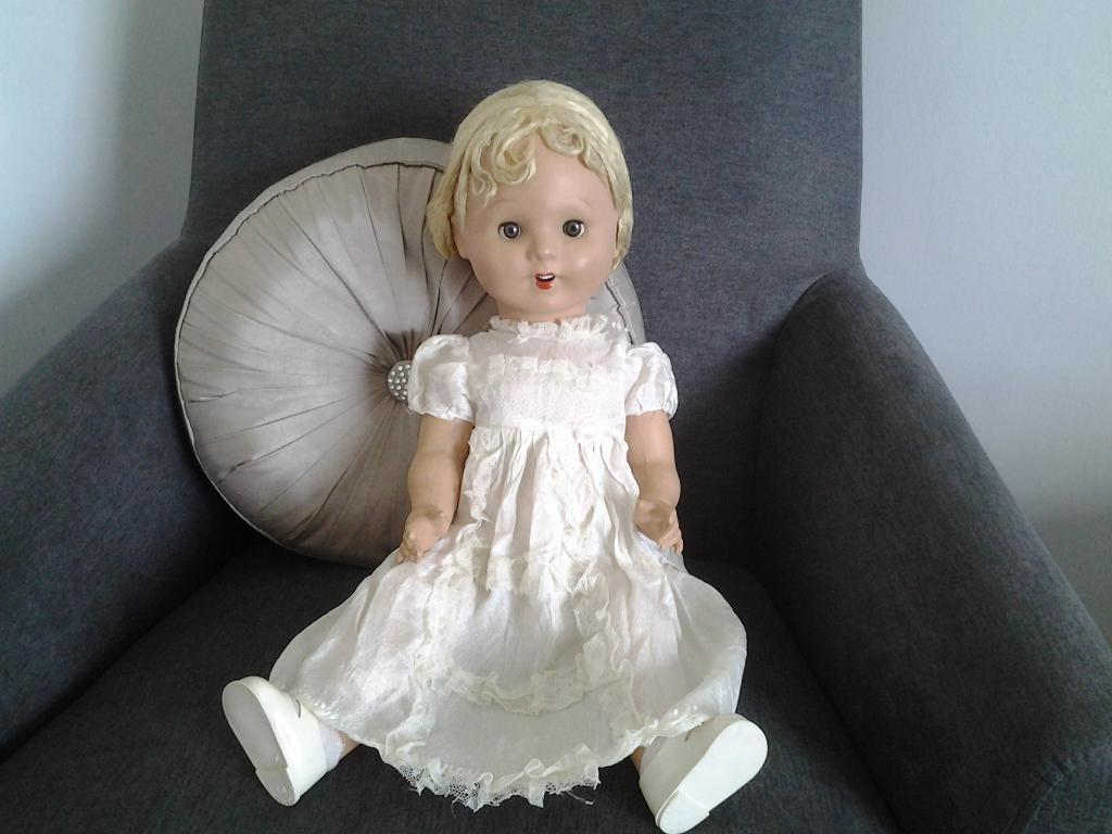 Antique bisque doll with closing eyes and crier