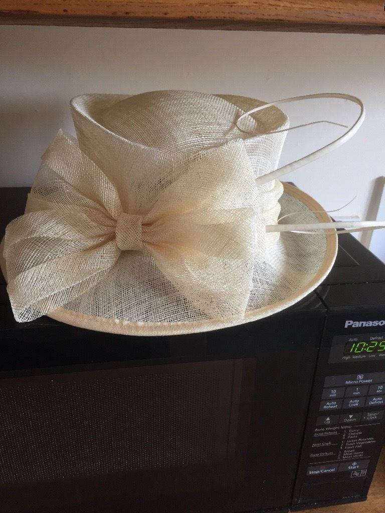Brand new cream hat with tags and hat box