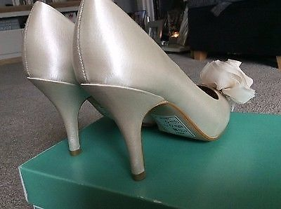 Brand new never worn wedding shoes size 4