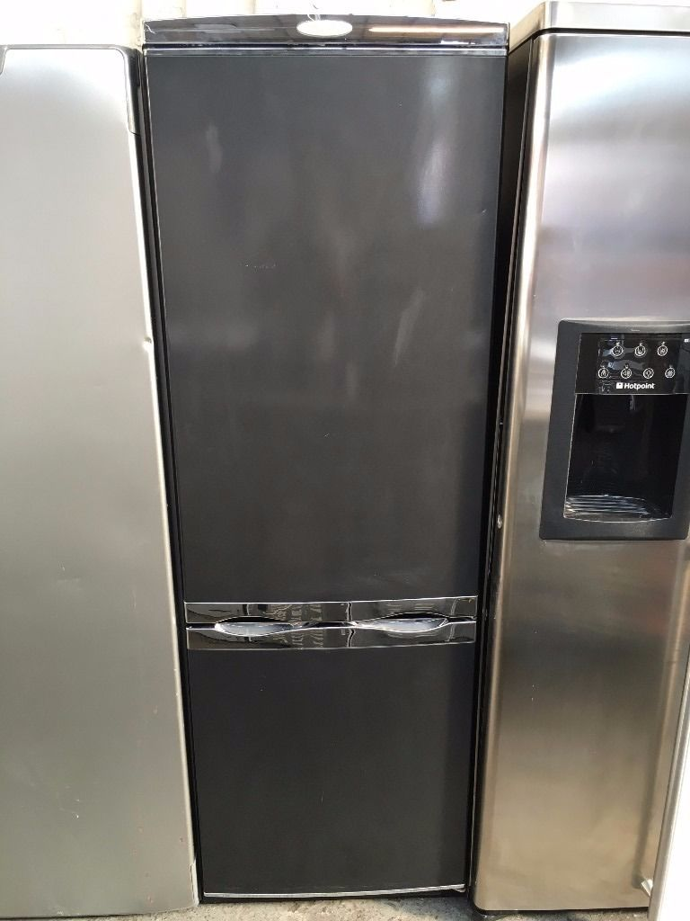 SERVIS free standing fridge freezer 6 ft tall nice condition & fully working order