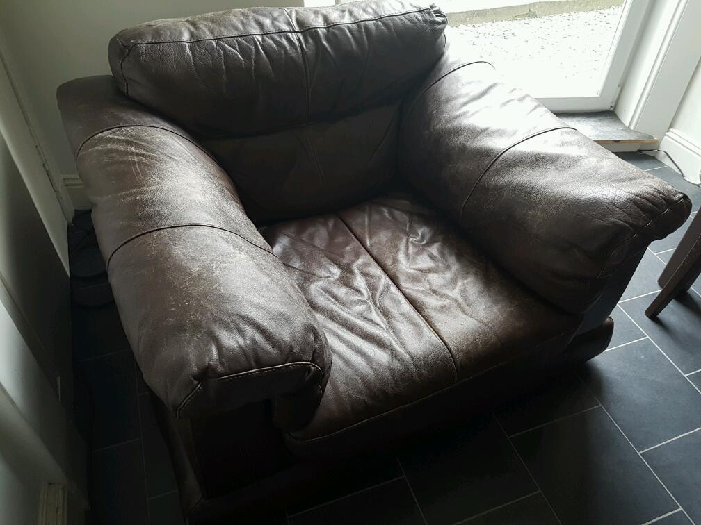 Free large brown leather armchair