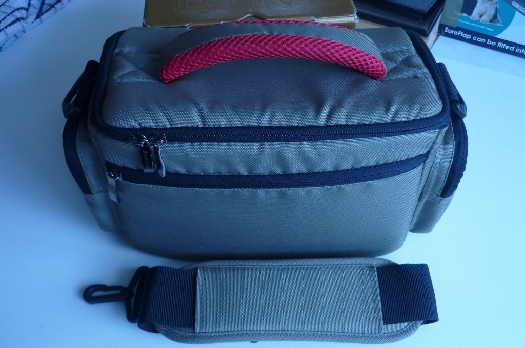 Jealiot Professional Camera Bag with weatherproof cover included.