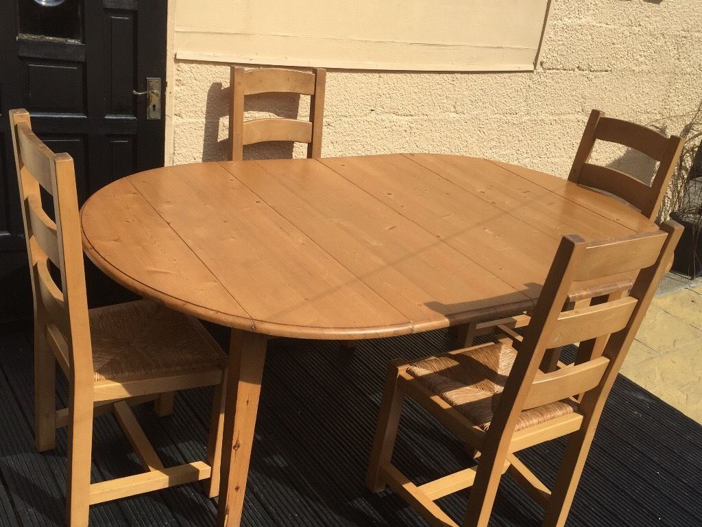 Solid Pine extentable table , with four solid pine chairs with wicker seats and solid pine cabinet