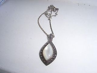 beautiful mother of pearl necklace with matching earrings.