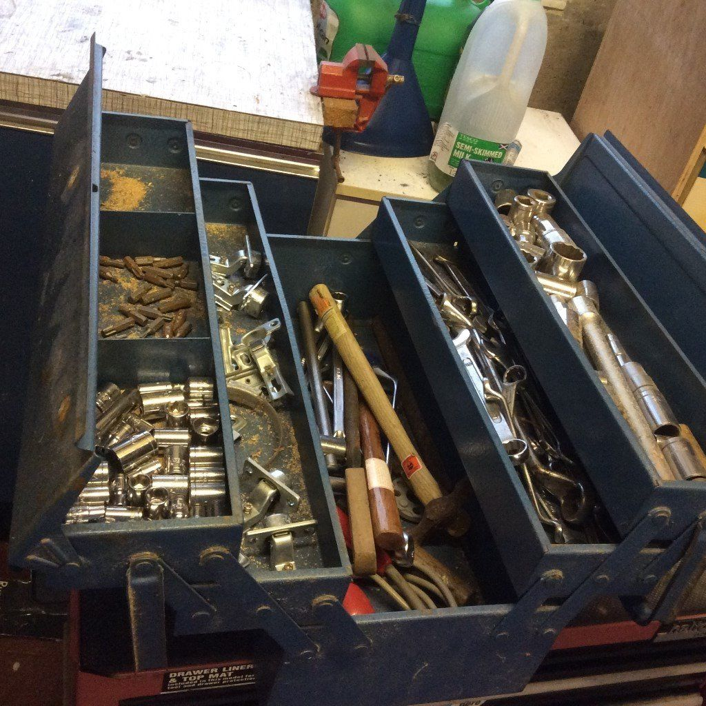 Metal portable tool box in good condition with some tools thrown in
