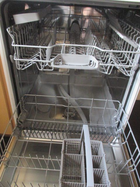 A white Bosch dishwasher- immaculate