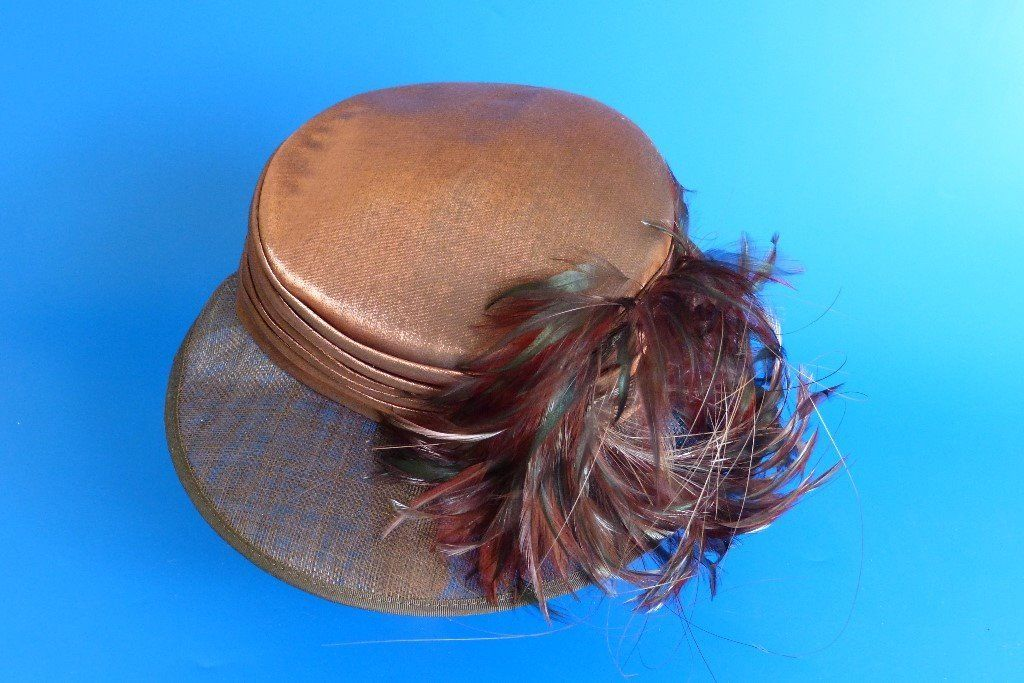 Gorgeous wedding hat bronze fabric with feathers on woven brim. John Lewis hat, worn once only.