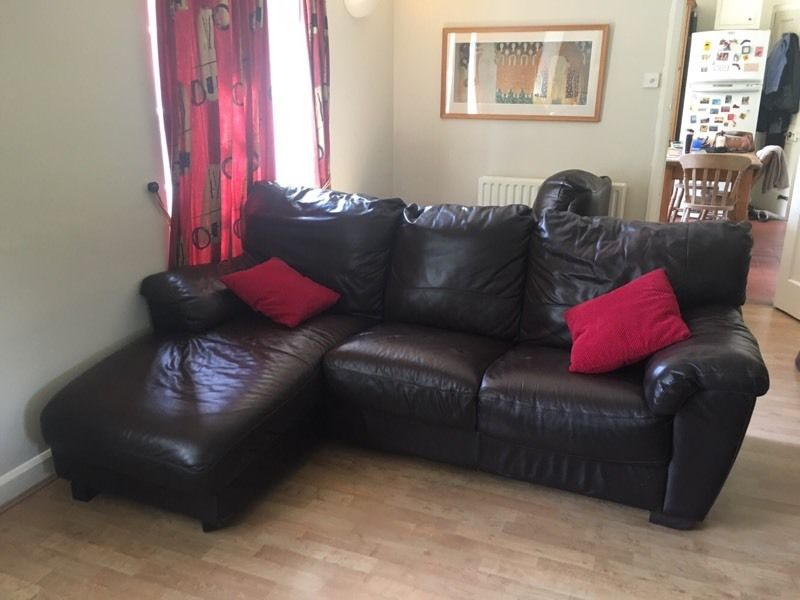 L shaped brown leather sofa