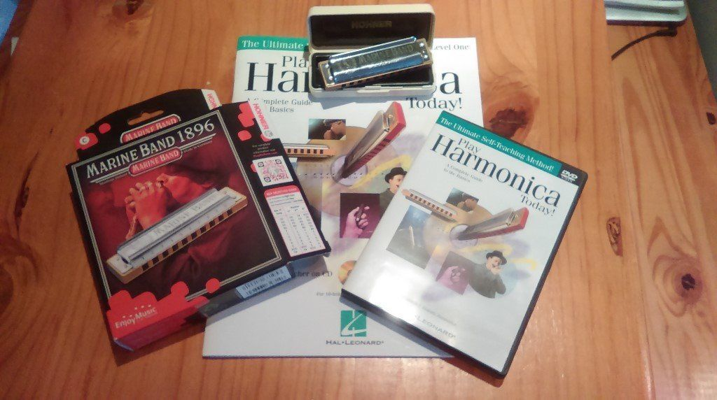 Marine Band Hohner harmonica in C. With Self teaching book and DVD. (As new in original box/casing)